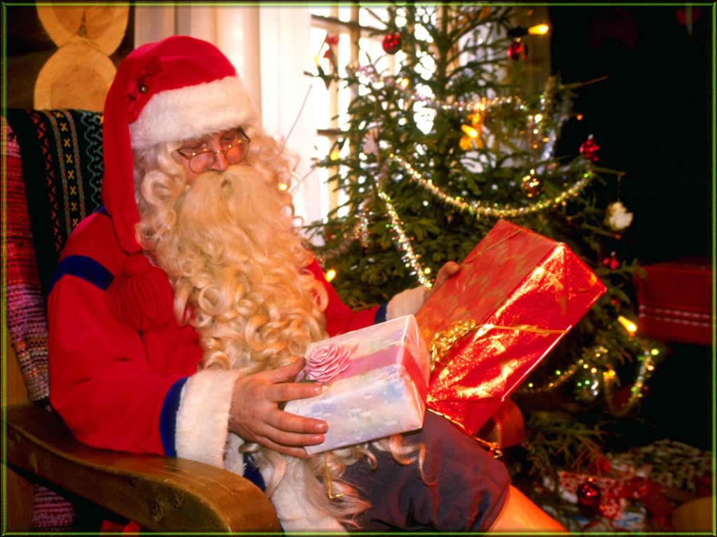 images2fanpopcom christmas santa present - Christmas Santa Pictures